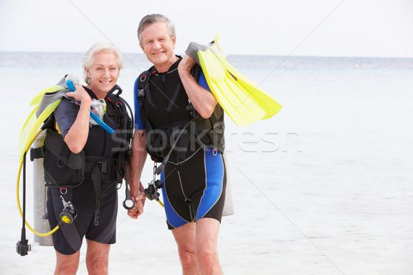 Senior Couple With Scuba Diving Equipment Enjoying Holiday Stock photo © monkey_business