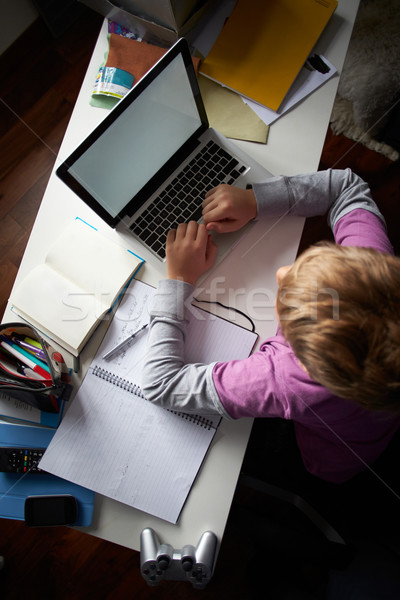Overhead View Of Boy Studying In Bedroom Using Laptop Stock photo © monkey_business