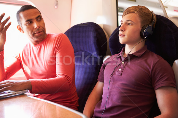 Young Man Disturbing Train Passengers With Loud Music Stock photo © monkey_business