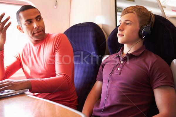 Jonge man trein passagiers luid muziek man Stockfoto © monkey_business