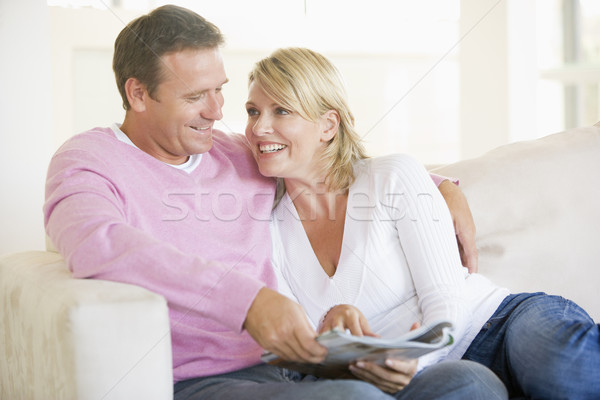Couple relaxing with a magazine and smiling Stock photo © monkey_business