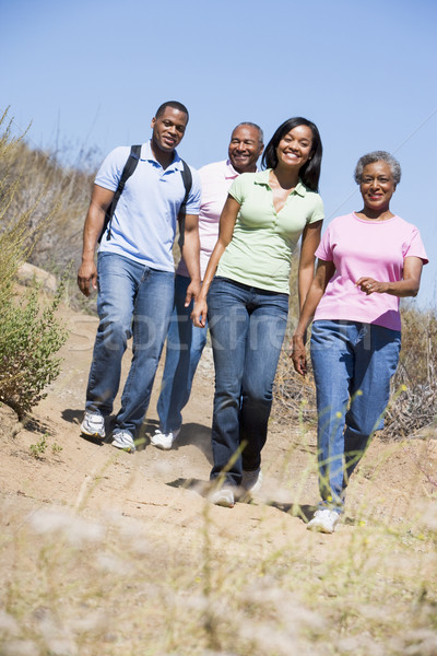 Two couples walking on path smiling Stock photo © monkey_business