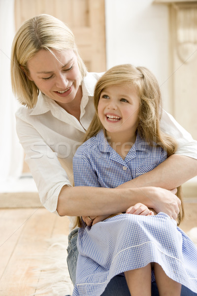 Woman in front hallway hugging young girl and smiling Stock photo © monkey_business