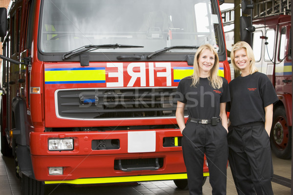 Portrait of two female firefighters standing by a fire engine Stock photo © monkey_business