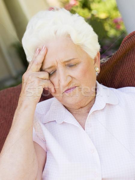 Femme maux de tête malade supérieurs couleur séance Photo stock © monkey_business