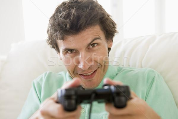 Stock fotó: Férfi · nappali · játszik · mosolyog · mosoly · férfi