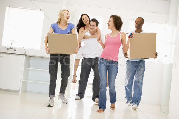Group of friends moving into new home smiling Stock photo © monkey_business