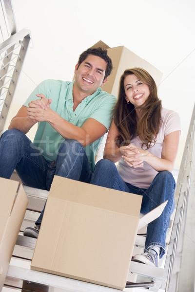 Pareja sesión escalera cajas nuevo hogar sonriendo Foto stock © monkey_business