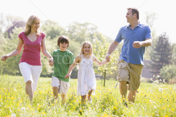 Family walking outdoors holding hands smiling Stock photo © monkey_business