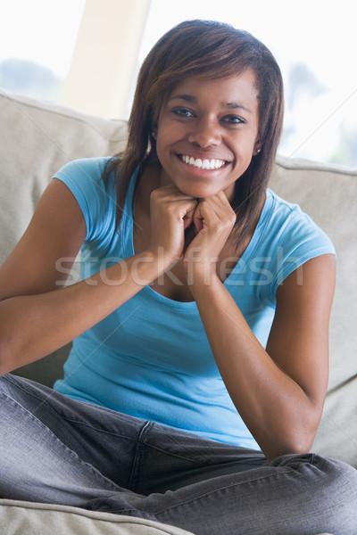 Retrato feliz adolescente sofá sessão Foto stock © monkey_business