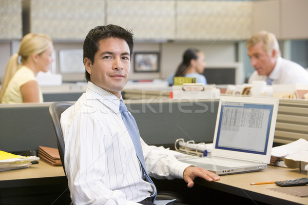 Businessman in cubicle with laptop Stock photo © monkey_business