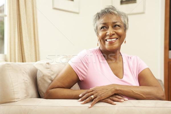 Starszy kobieta relaks krzesło domu szczęśliwy Zdjęcia stock © monkey_business