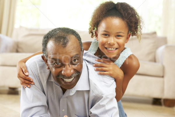 Grand-père petite fille jouer ensemble maison heureux Photo stock © monkey_business