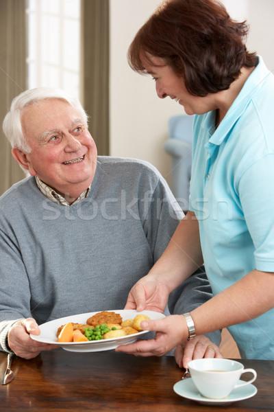 Idős férfi felszolgált étel gondozó egészség Stock fotó © monkey_business
