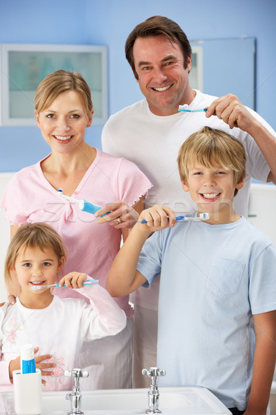 Family cleaning teeth together in bathroom Stock photo © monkey_business