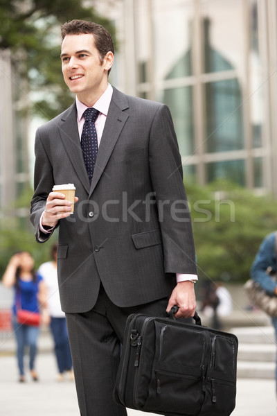 Stock photo: Businessman Walking Along Street Holding Takeaway Coffee