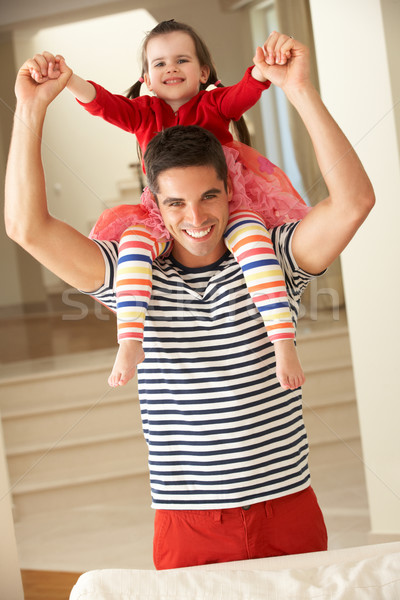 Father Giving Daughter Ride On Shoulders At Home Stock photo © monkey_business