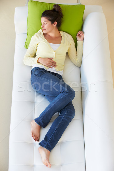 Overhead View Of Woman Relaxing On Sofa Stock photo © monkey_business