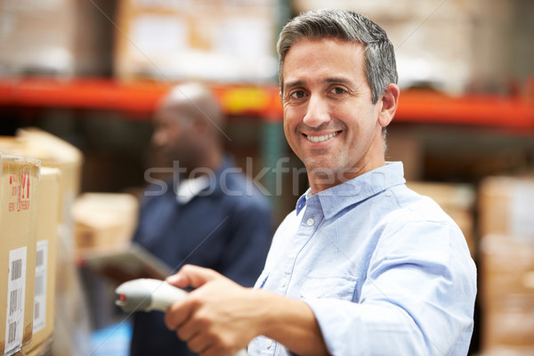 Worker Scanning Package In Warehouse Stock photo © monkey_business