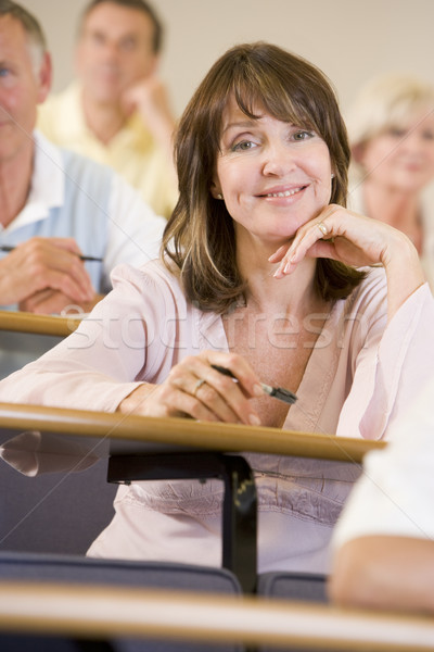 Femenino adulto estudiante escuchar Universidad conferencia Foto stock © monkey_business
