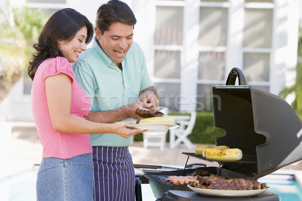 Couple cuisson barbecue heureux jardin couleur Photo stock © monkey_business