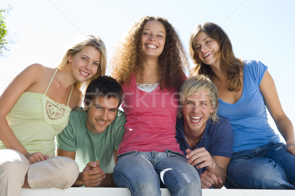 Five people on balcony smiling Stock photo © monkey_business