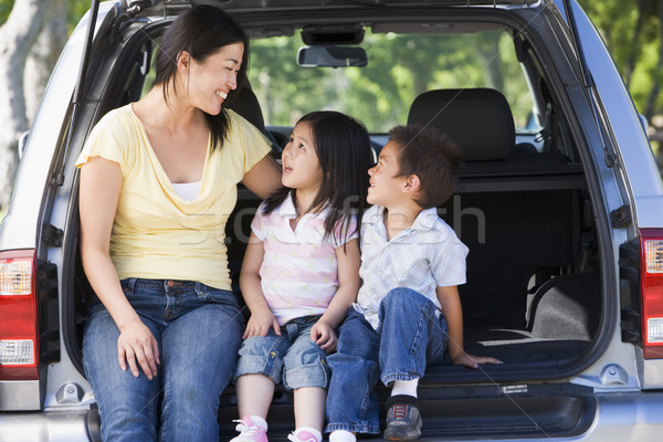 Woman with two children sitting in back of van smiling Stock photo © monkey_business