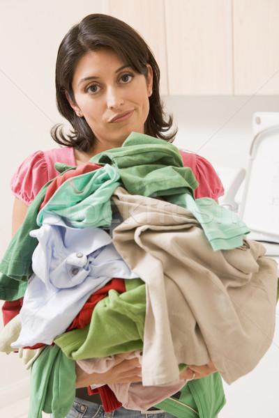 Stock photo: Woman Holding Pile Of Laundry