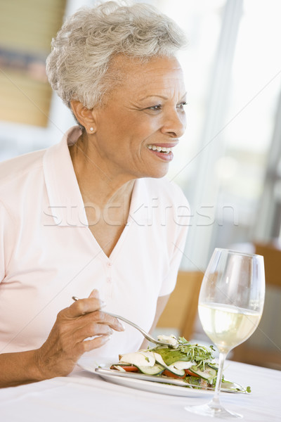 Woman Enjoying meal,mealtime With A Glass Of Wine Stock photo © monkey_business