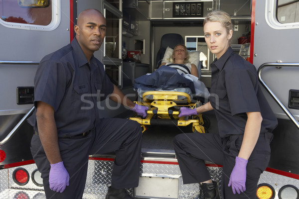 Paramedics preparing to unload patient from ambulance Stock photo © monkey_business