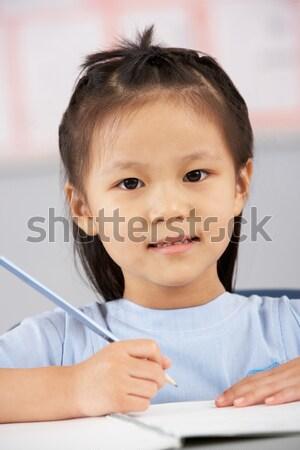 Studentessa seduta primaria classe studente iscritto Foto d'archivio © monkey_business