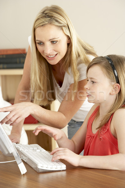 Mother And Daughter At Home Using Computer Stock photo © monkey_business