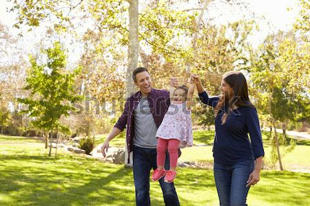 Stock photo: Young Family Outdoors Walking Through Park
