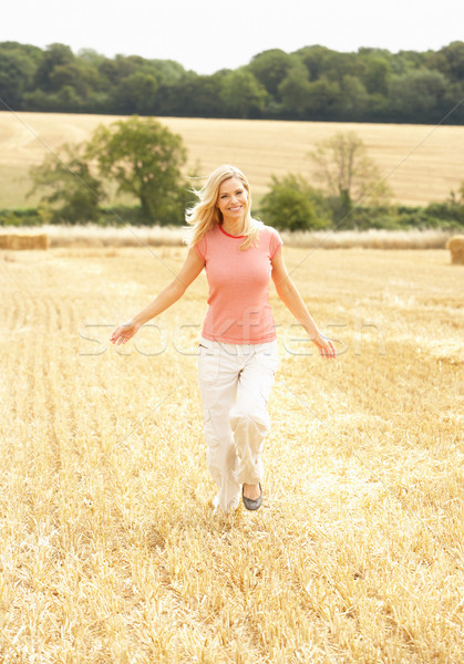 Woman Running Through Summer Harvested Field Stock photo © monkey_business