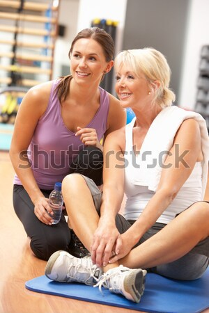 Woman Doing Stretching Exercises In Gym With Trainer Stock photo © monkey_business