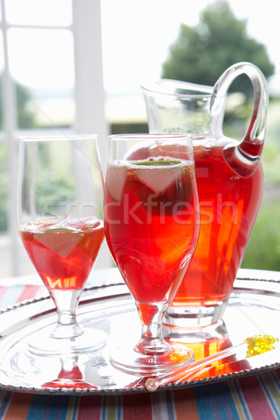 Fruit drink in a decanter and glasses Stock photo © monkey_business