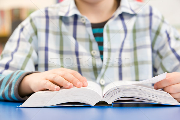 Close Up Of Schoolboy Studying Textbook In Classroom Stock photo © monkey_business