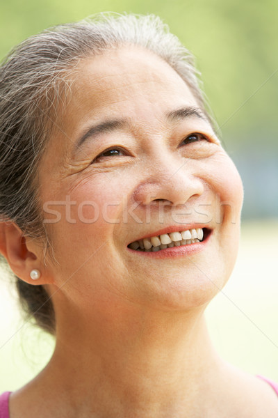 Head And Shoulders Portrait Of Attractive Chinese Senior Woman Stock photo © monkey_business