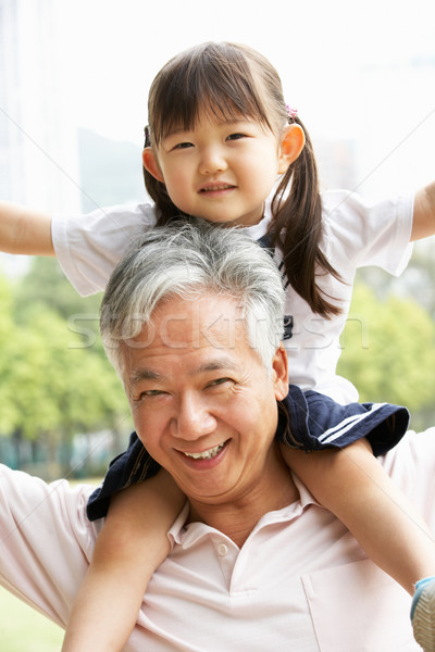 Chinese Grandfather Giving Granddaughter Ride On Shoulders In Pa Stock photo © monkey_business