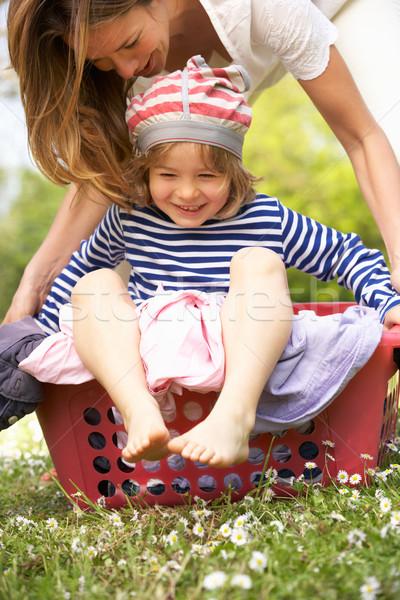 Mère fils séance panier à linge femme Photo stock © monkey_business