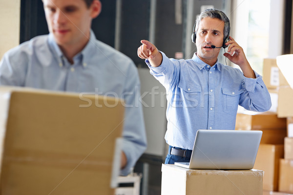 Manager Using Headset In Distribution Warehouse Stock photo © monkey_business
