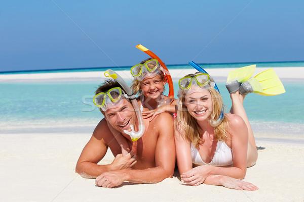 Family With Snorkels Enjoying Beach Holiday Stock photo © monkey_business