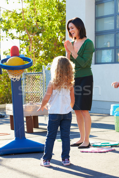 Teacher Supervising Breaktime At Elementary School Stock photo © monkey_business
