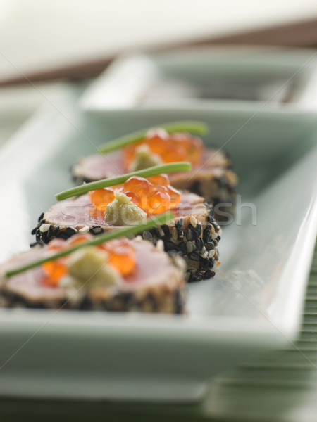 Seared Yellow Fin Tuna Rolled in Sesame seeds with Wasabi and Sa Stock photo © monkey_business