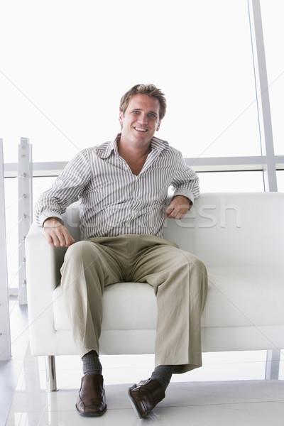 üzletember ül iroda lobbi mosolyog mosoly Stock fotó © monkey_business