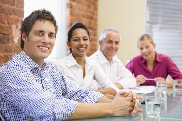 Cztery sali konferencyjnej uśmiechnięty tabeli ludzi biznesu Zdjęcia stock © monkey_business