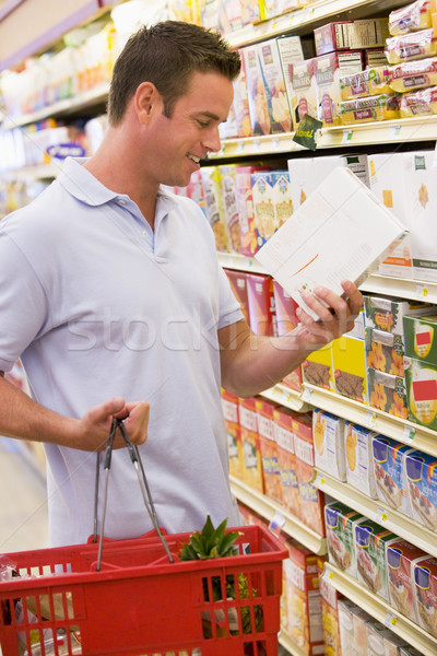 Man checking food labelling in supermarket Stock photo © monkey_business