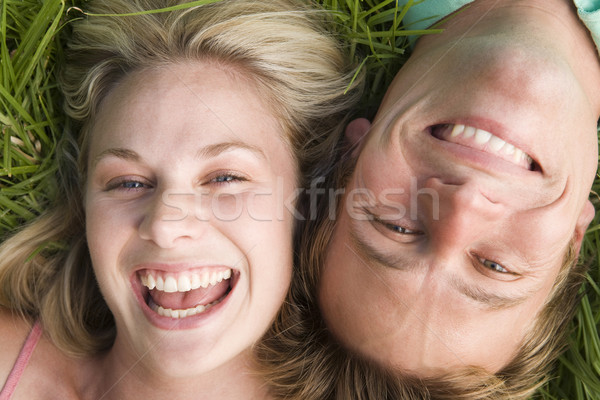 Couple lying in grass smiling Stock photo © monkey_business