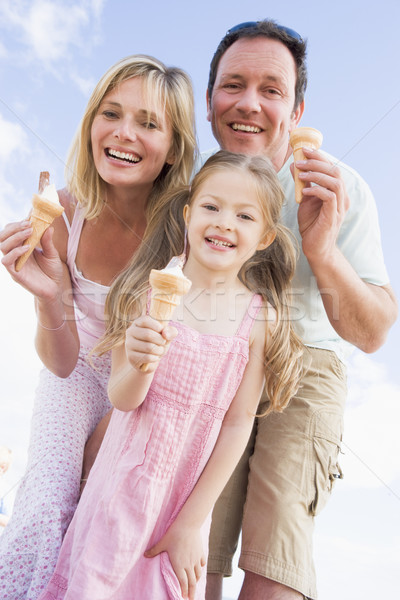 Family standing outdoors with ice cream smiling Stock photo © monkey_business