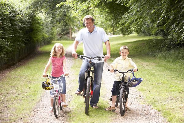 Pai crianças equitação bicicletas feliz Foto stock © monkey_business
